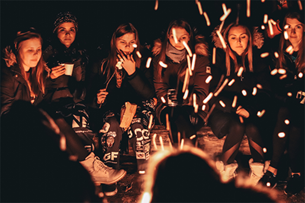 girls_at_bonfire@2x